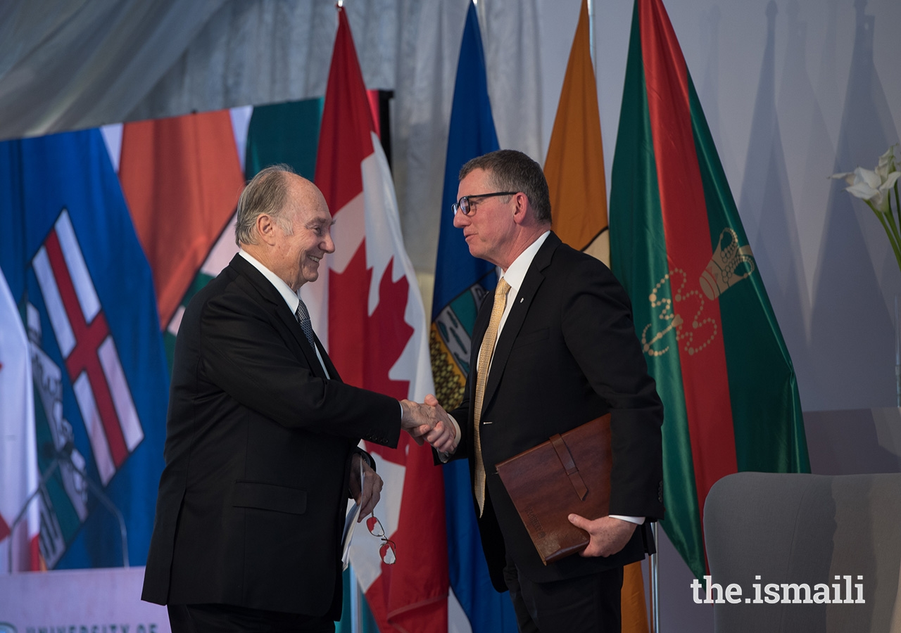 Mawlana Hazar Imam and University of Alberta President David Turpin shake hands after Hazar Imam delivers his remarks at the Aga Khan Garden inauguration ceremony.