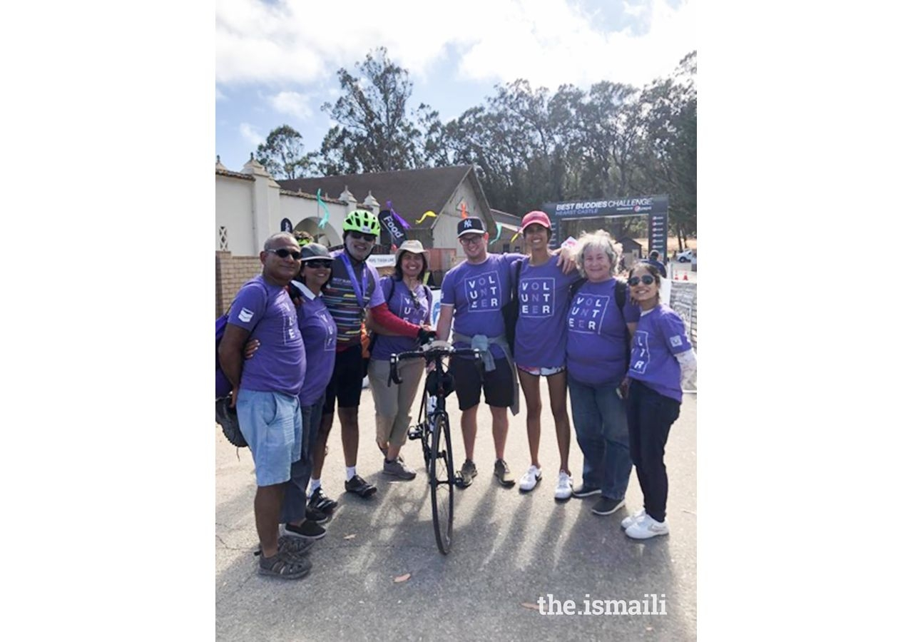 Volunteers and riders after the finish line.