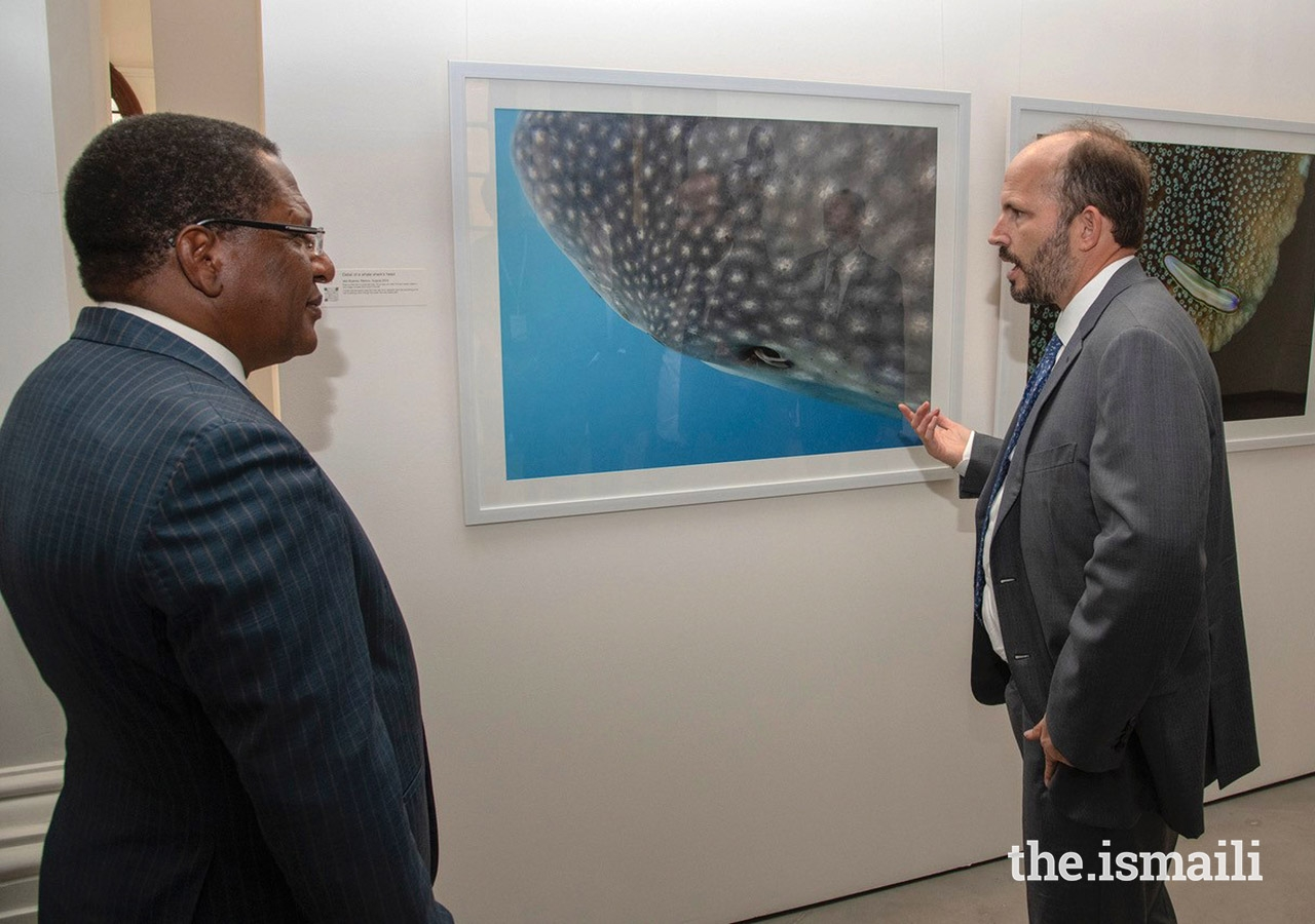 "Prince Hussain on a tour of the gallery with Cabinet Secretary Honourable Keriako Tobiko. During a speech at the event, Honourable Keriako Tobiko commended Prince Hussain for ""a true display of exceptional passion for marine ecosystems"" and for using photography to inform and educate audiences about ""the diversity that exists in our seas and oceans."""