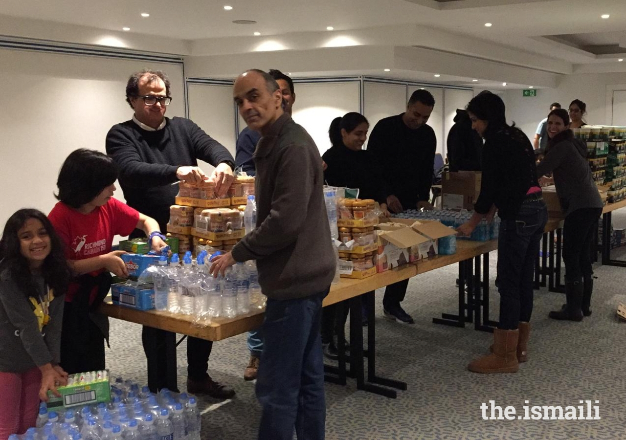 Members of the Jamat in the UK gather to pack sustenance bags for homeless and vulnerable individuals in London.