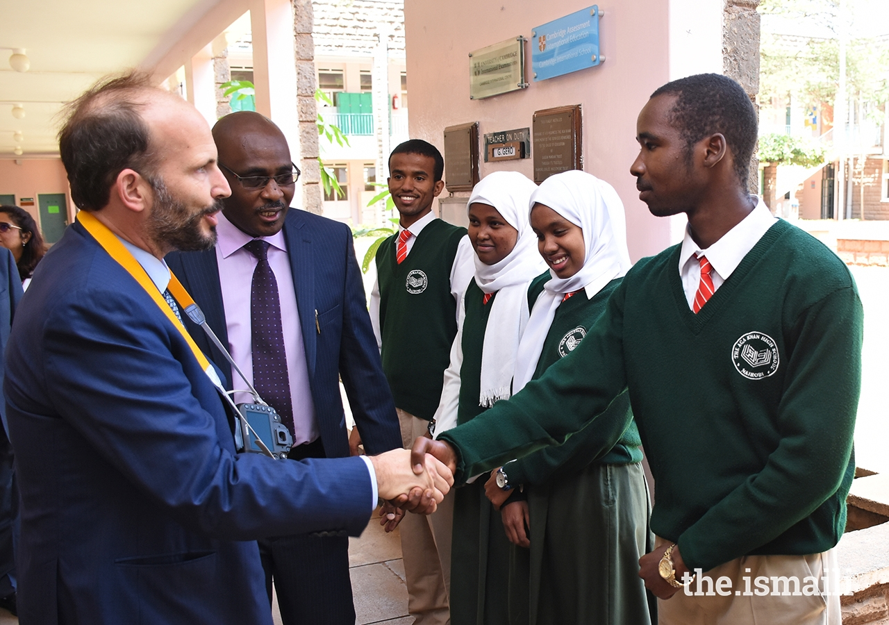 Principal Ambrose Maina introduces Prince Hussain to senior prefects during the Prince's visit to the Aga Khan High School, Nairobi.