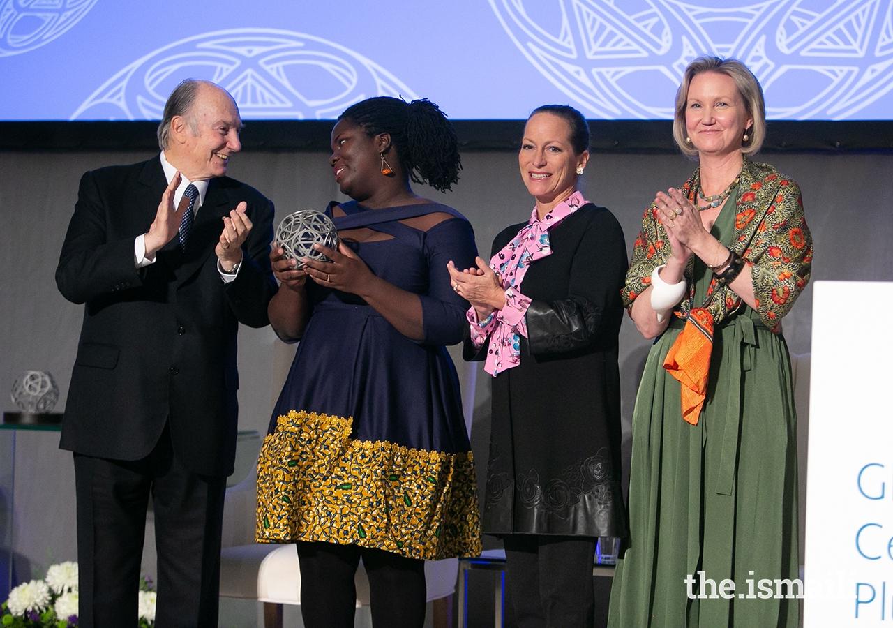 Deborah Ahenkorah, co-founder of Golden Baobab, poses for a photo with Mawlana Hazar Imam, Princess Zahra, and Global Centre for Pluralism Secretary General Meredith Preston McGhie.