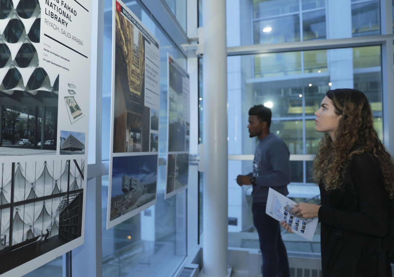 Young students study the various nominated and winning projects of the 2016 Aga Khan Award for Architecture cycle displayed at the exhibition.