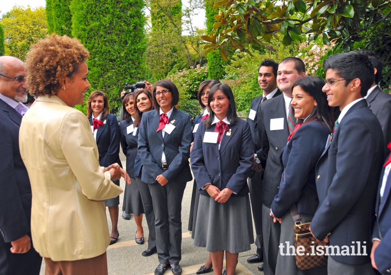 Michaëlle Jean, former Governor General of Canada, speaks with volunteers in the courtyard at the Ismaili Centre Burnaby.