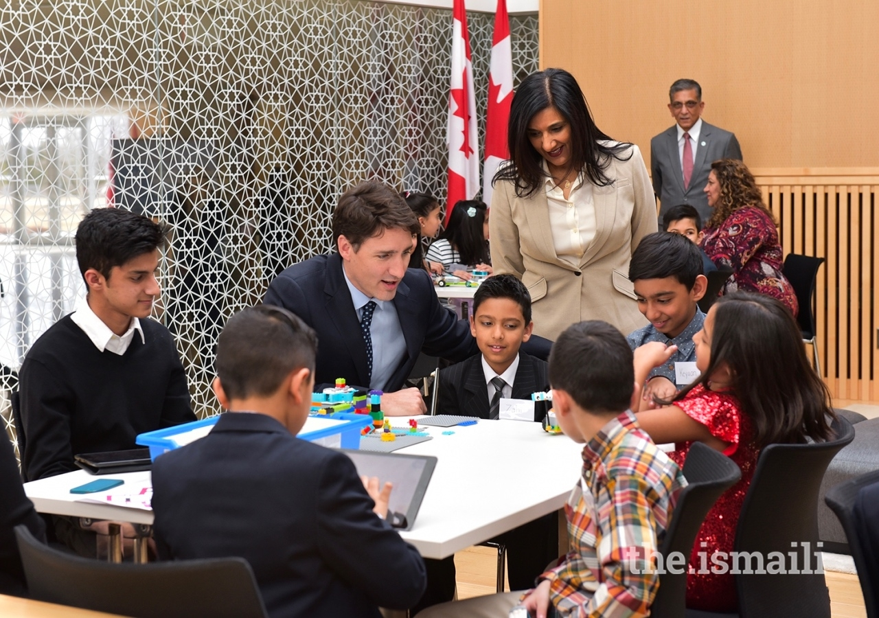 Canadian Prime Minister Justin Trudeau discusses Navroz activities with children at the Ismaili Centre Toronto.