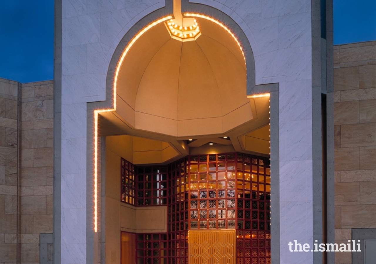 The principal entrance of the Ismaili Centre, Vancouver, takes the form of a niche, emanating a lamp-like light.