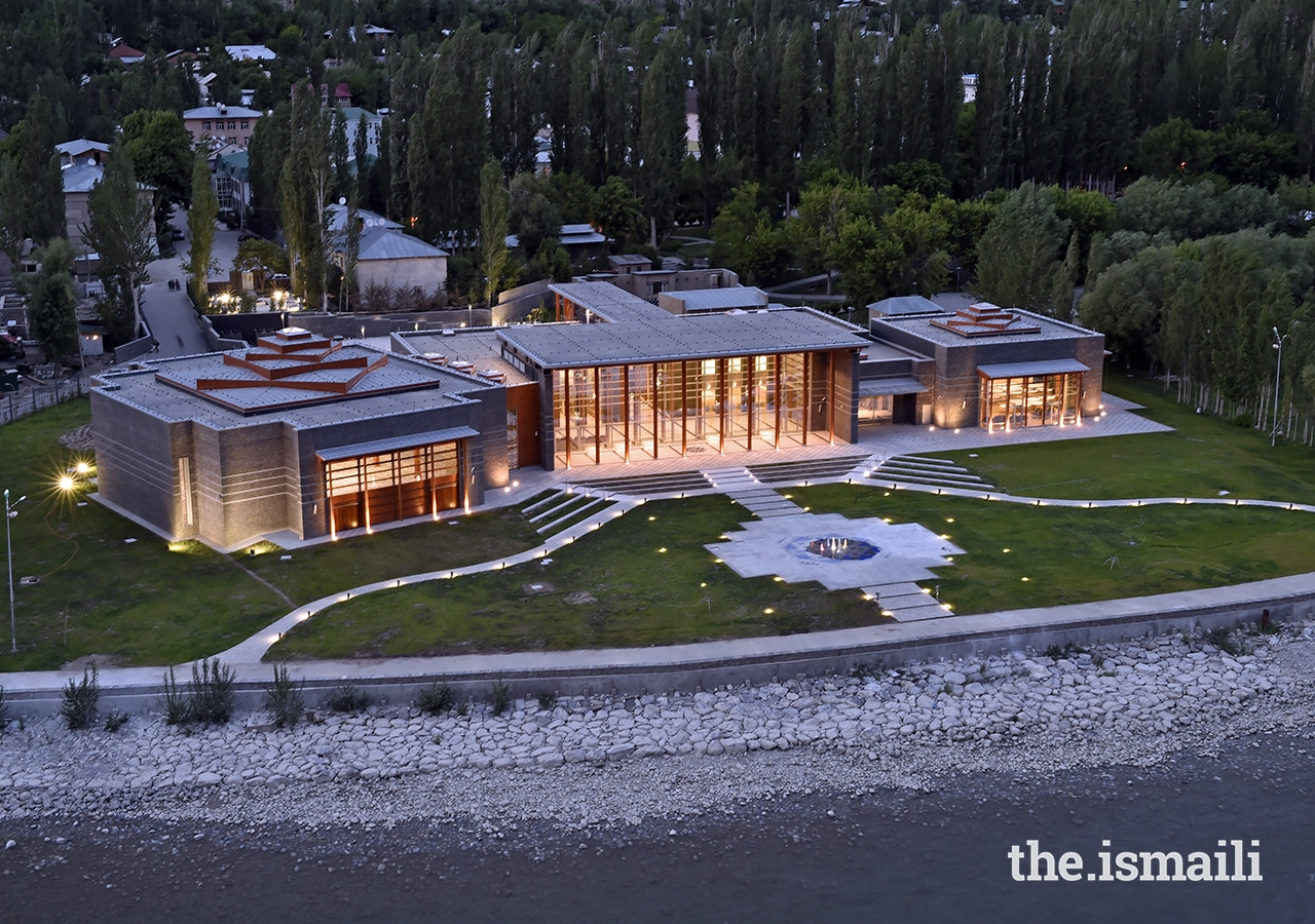 An evening view of the civic plaza, highlighting the radiant glow of the Ismaili Jamatkhana and Centre, Khorog.