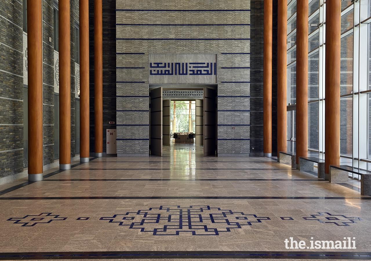 "The social hall portal entrance at the Ismaili Jamatkhana and Centre, Khorog. The geometric Kufic script above the portal reads: ""Al-hamdu lillahi rabil 'alamin."""