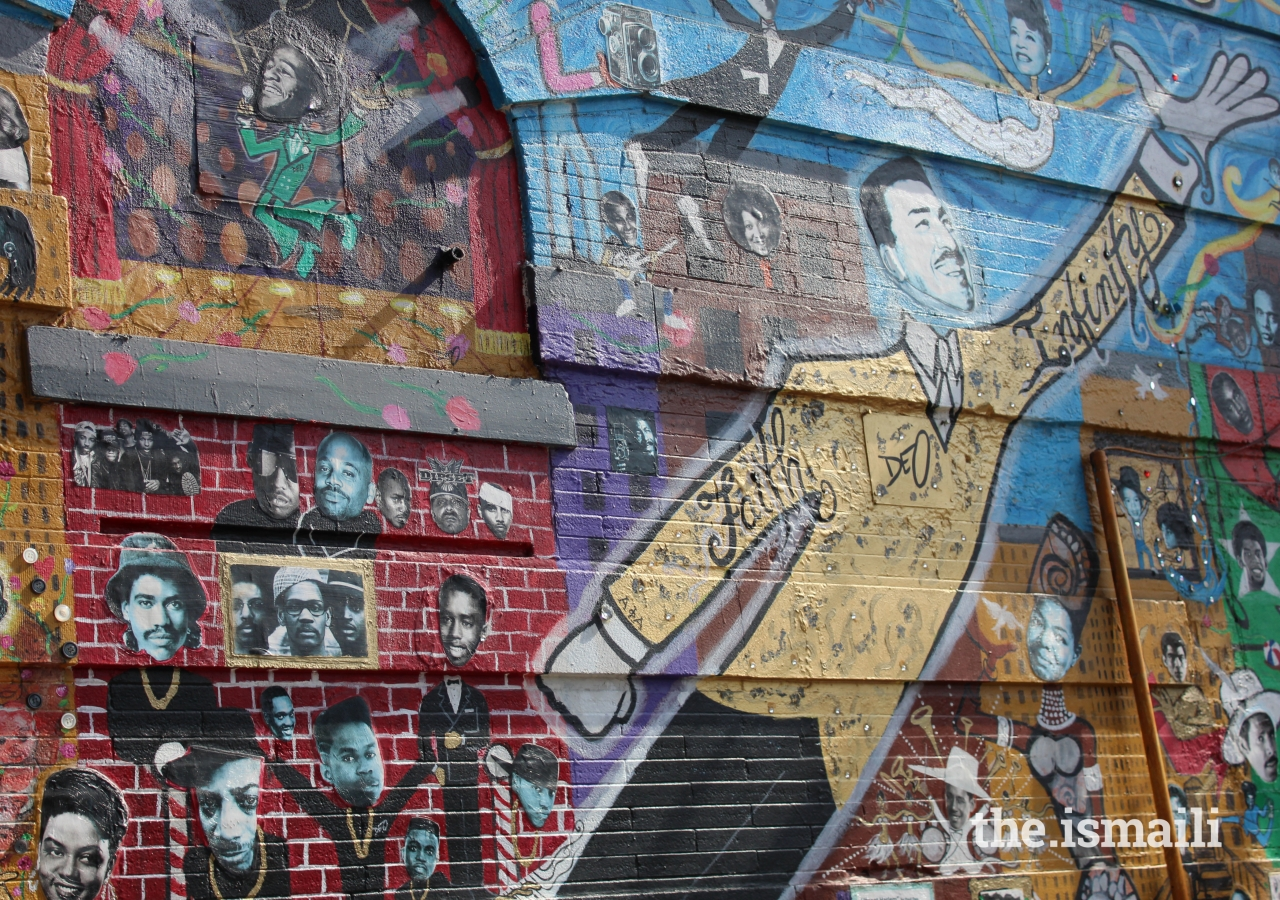 The painted Planet Harlem mural at the corner of Malcolm X Boulevard and West 126th Street features prominent leaders advancing social justice causes, including notable early adopters of Islam.