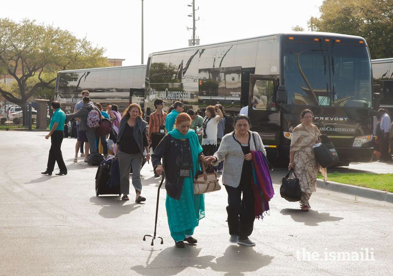 Seniors from the Dallas/Fort Worth area arrive in Houston on shuttles driven by Jamati volunteers.