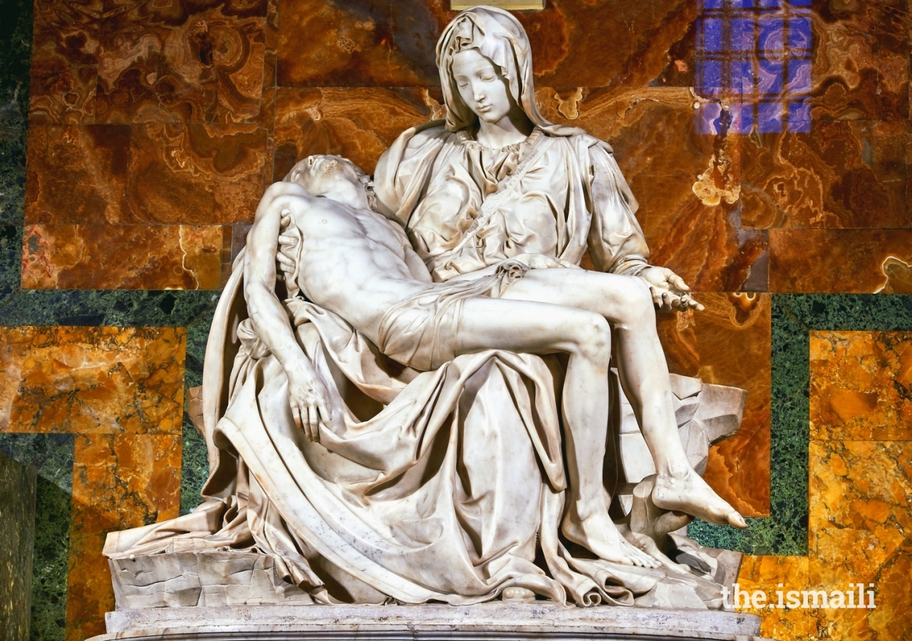 Michelangelo's Pieta, depicting Mary cradling Jesus, sculpted in 1499 and housed in St. Peter's Basilica, Vatican City.