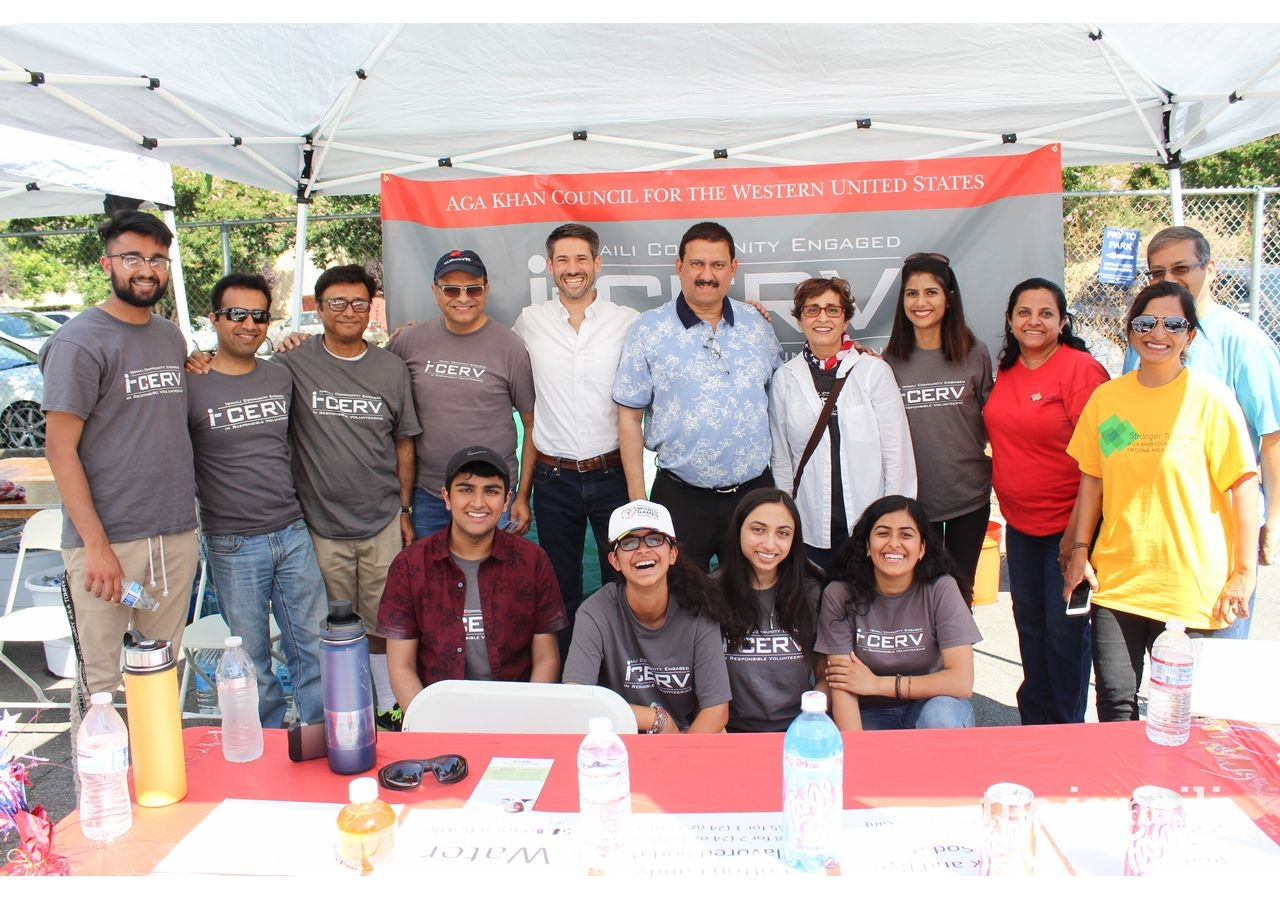 The northern California I-cerv team at San Jose's 4th of July event take a picture with San Jose civic leaders, including candidate Matt Mahan.