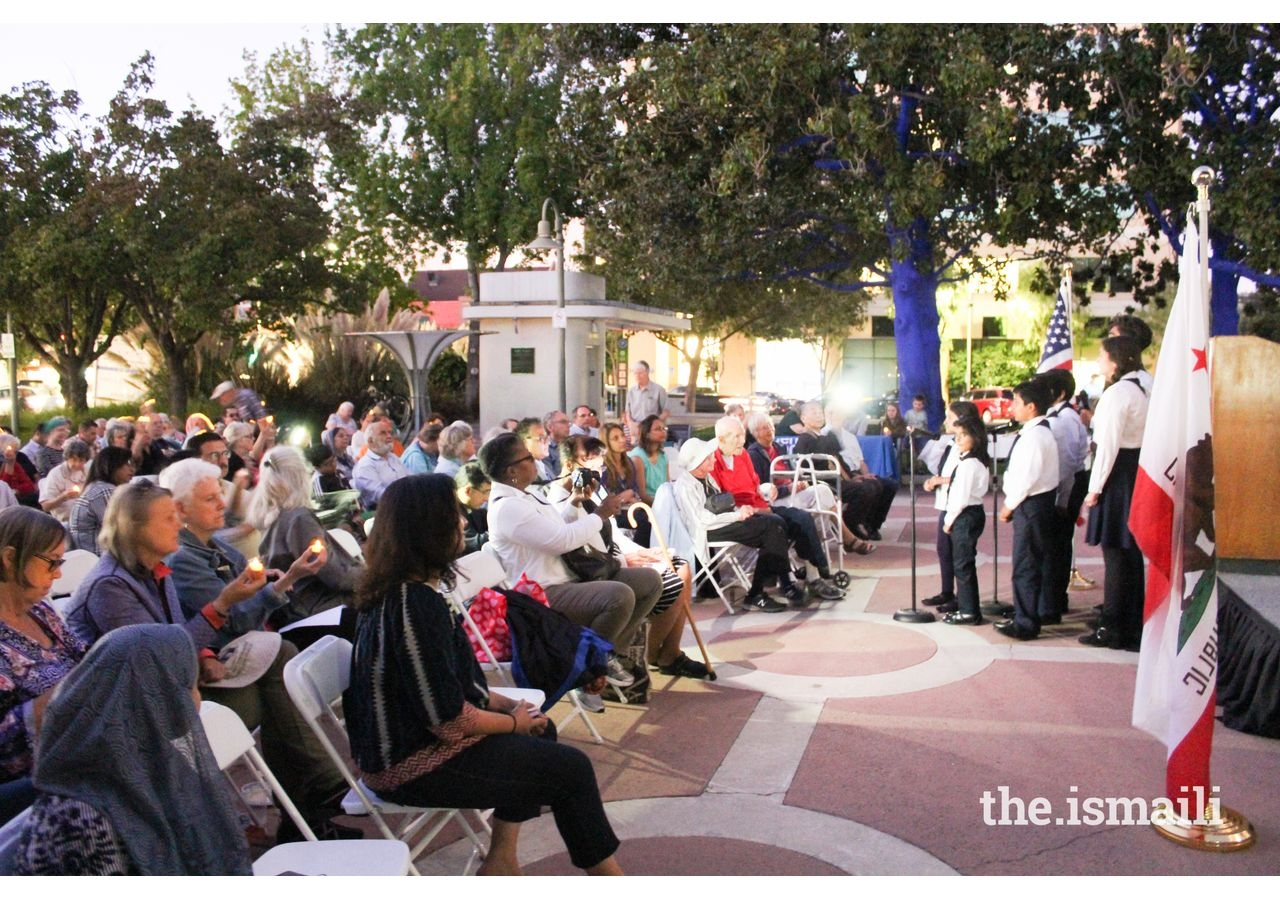 The Bay Area Ismaili Choir performs to a crowd outside Palo Alto City Hall on September 11, 2019.
