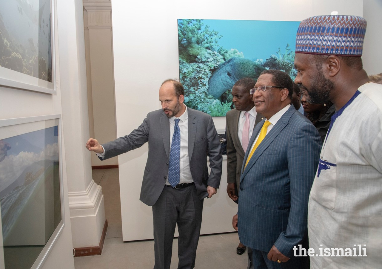 Guests listen keenly, enthralled by Prince Hussain's experiences with the beautiful and fragile marine life detailed in his photographs. (L to R) Prince Hussain, Alex Awiti, Vice-Provost, Aga Khan University, Cabinet Secretary Honourable Keriako Tobiko and panelist Dr Cyrille-Lazare Siewe.