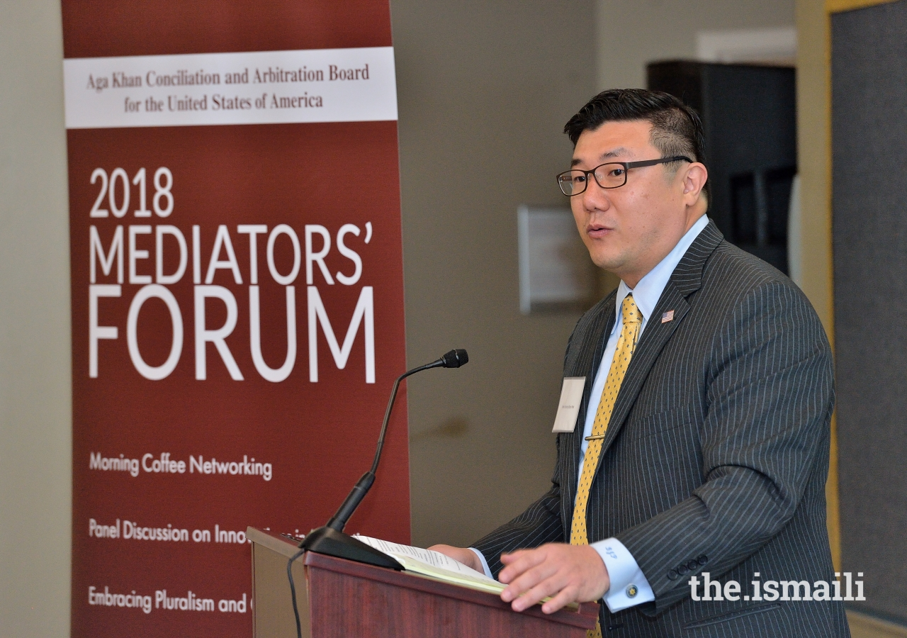 United States Attorney, BJay Pak delivers opening remarks at the 2018 Mediators Forum held at the Ismaili Jamatkhana in Decatur, Georgia.