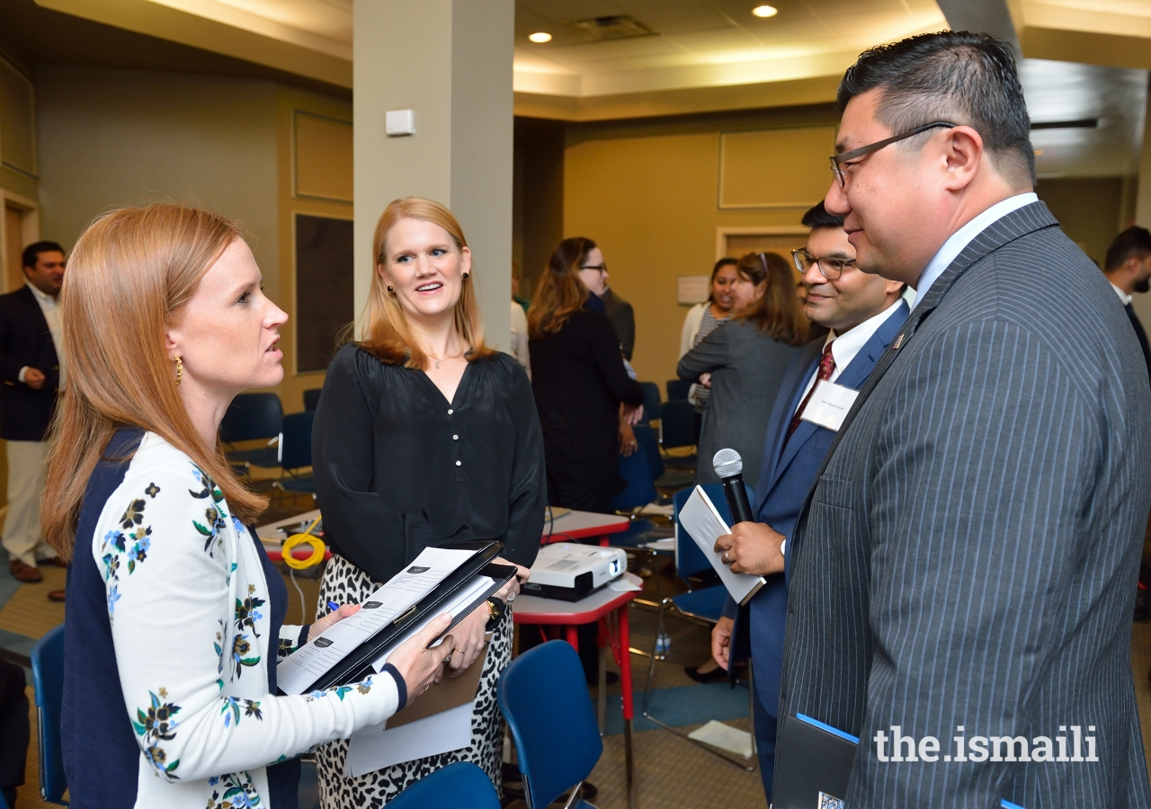 Participants engage in conversations and share best practices.