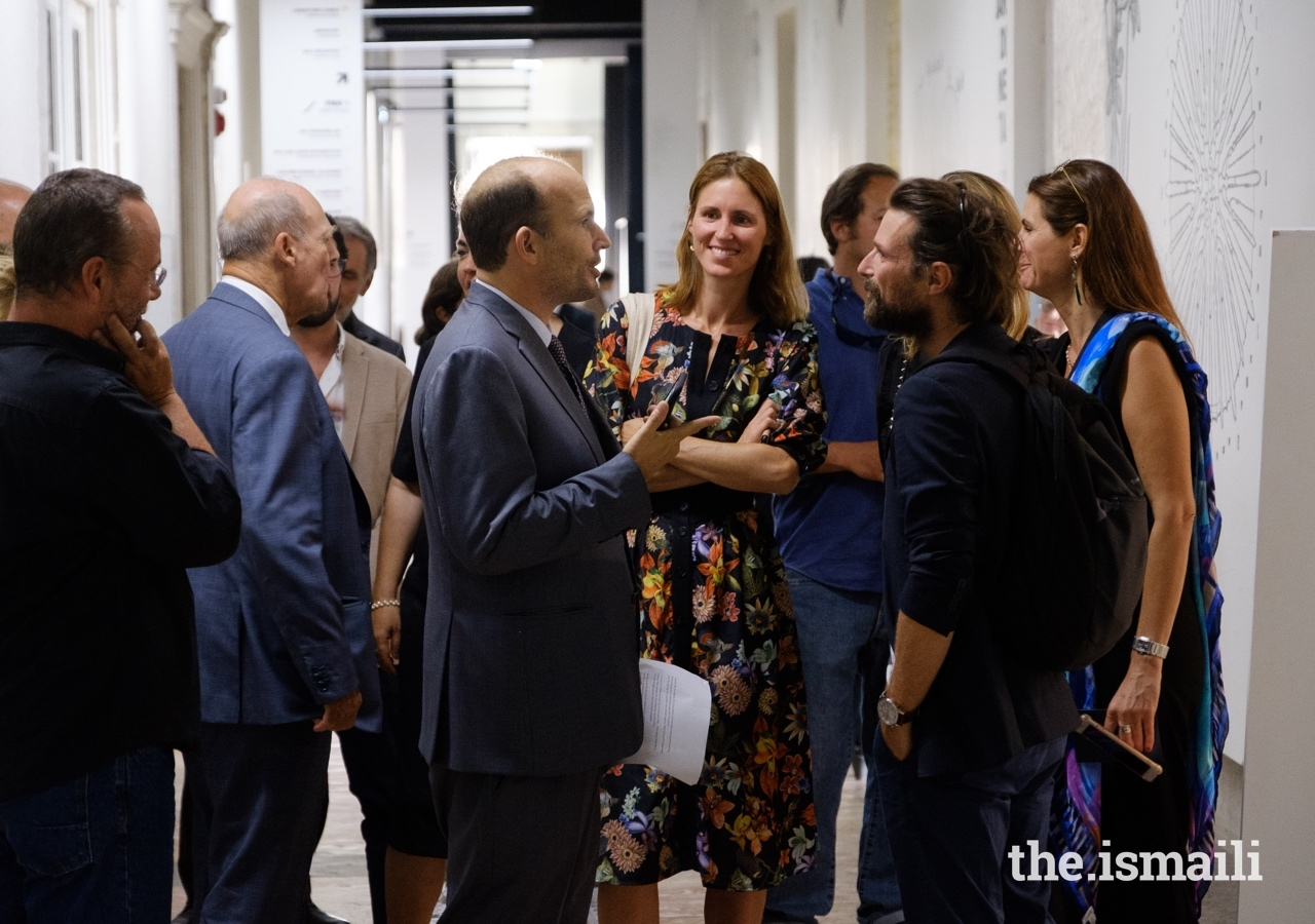 Prince Hussain in conversation with guests gathered at the inauguration of his The Living Sea photo exhibition in Lisbon.