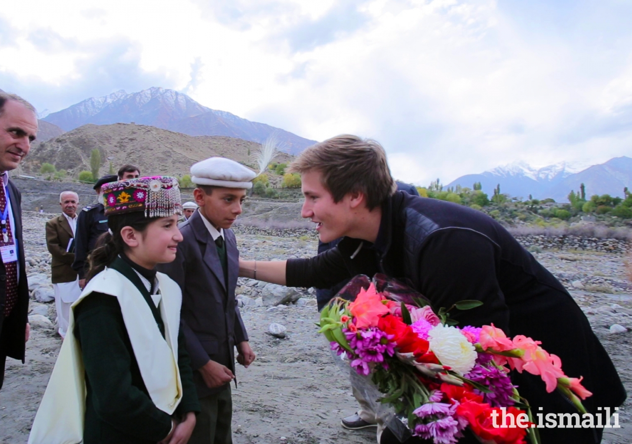 Prince Aly Muhammad is presented a bouquet of flowers upon his arrival in Immit, Ishkoman Punyal, Gilgit-Baltitsan in October 2017.