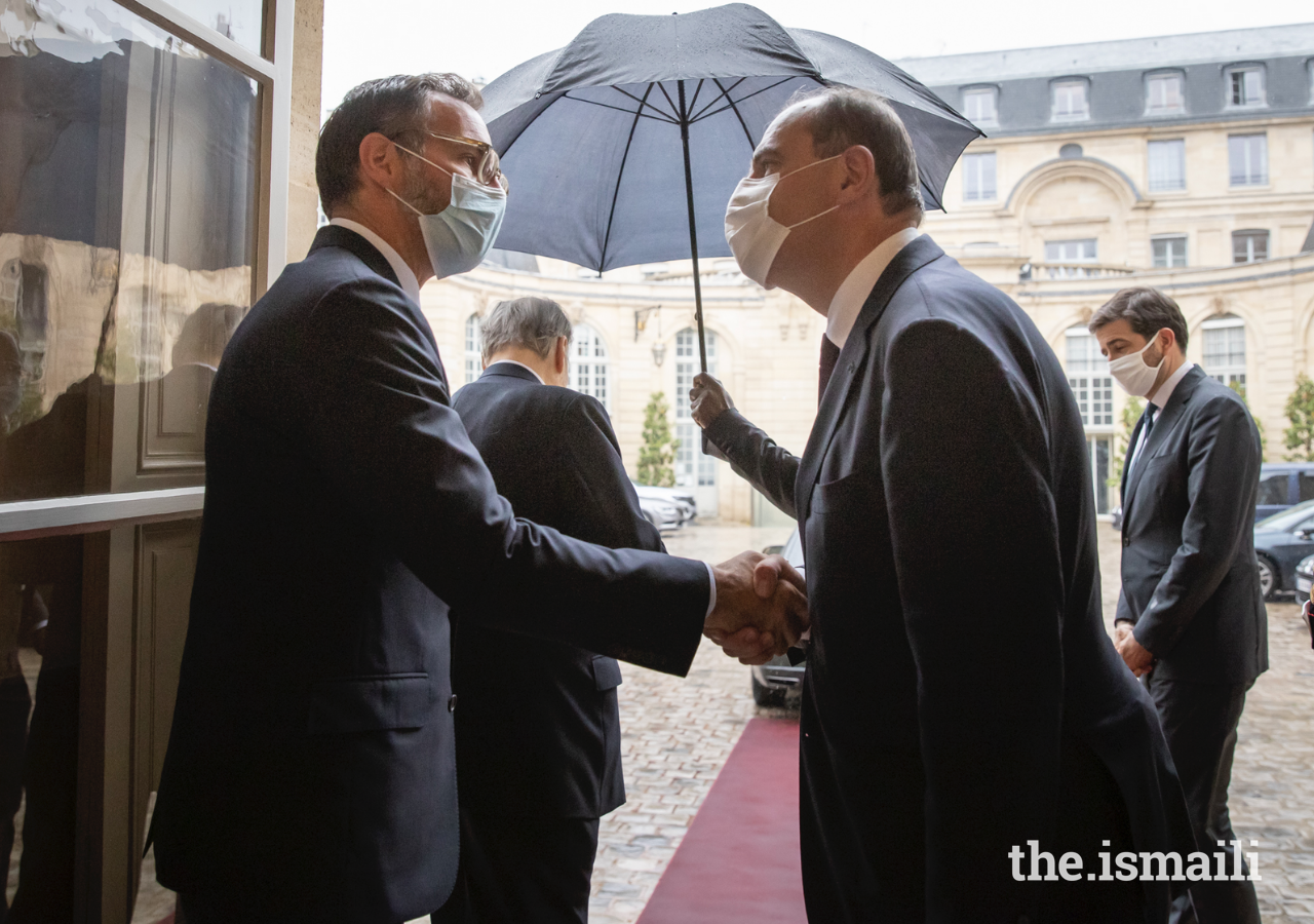 Prime Minister Jean Castex bids farewell to Prince Rahim after their meeting in Paris on 13 July 2021.