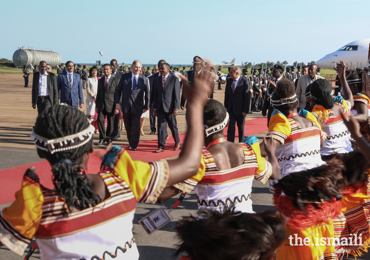 Mawlana Hazar Imam is greeted by local dancers performing a traditional welcome.