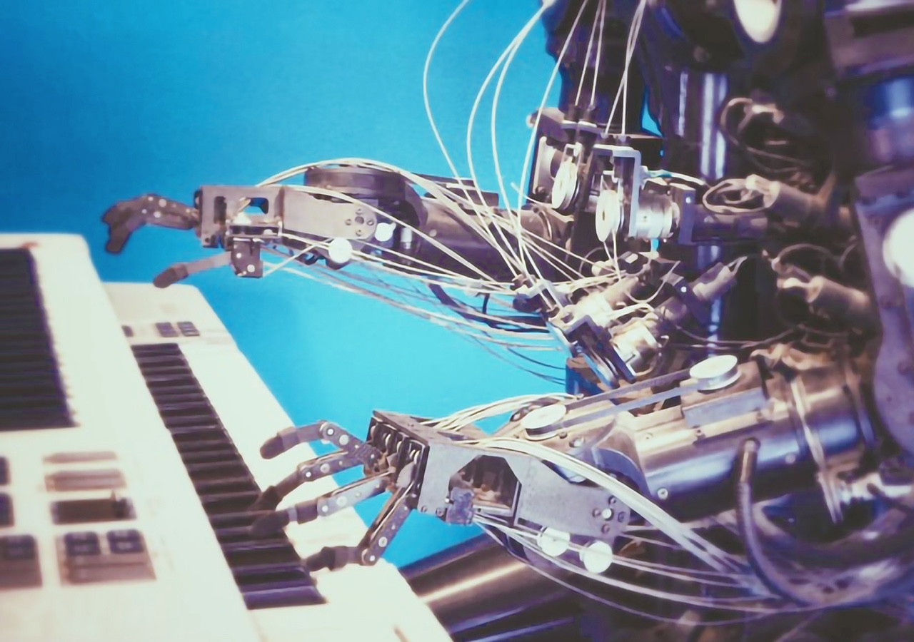 A robot programmed to play the piano.