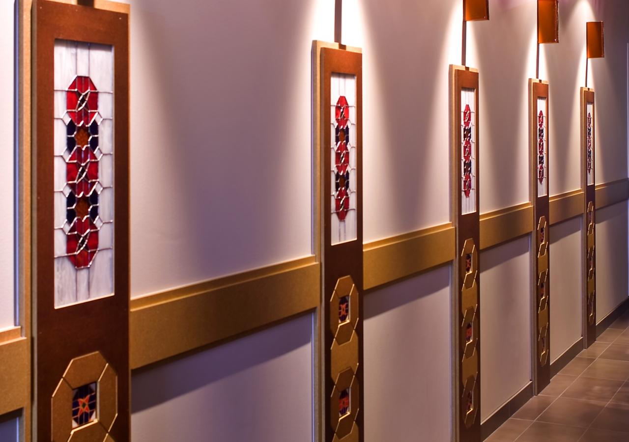 Decorative wall tiles in the octagonal motif of the Jamatkhana adorn the walls.