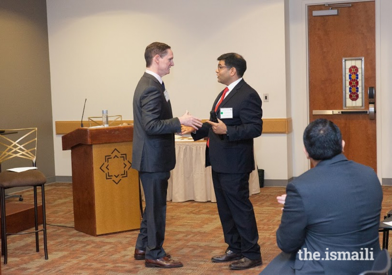 Clay Jenkins, head of the Dallas County government (left) is invited to address the assembled mediators by Kamran Jivani, National CAB Board member.