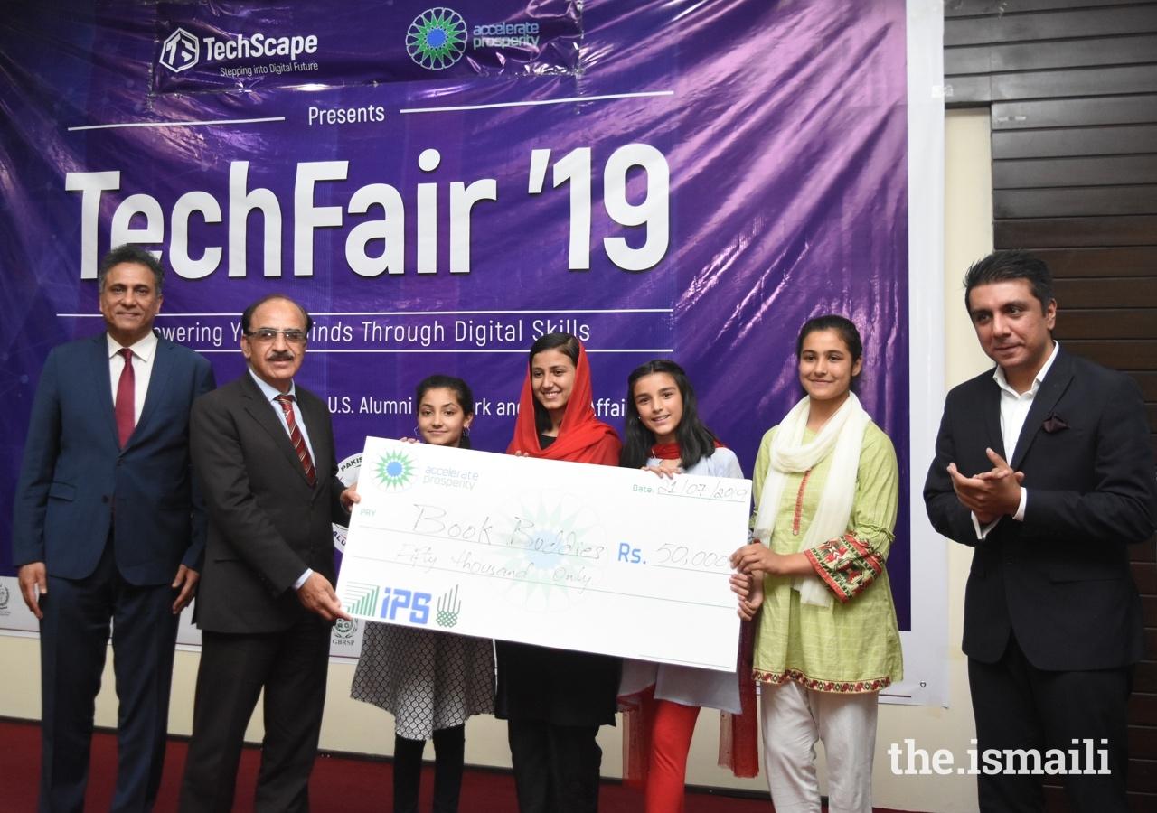 Anusha Sadruddin, Maliha Ali, Shabina Shah, and Muskan Nisar from the Aga Khan Higher Secondary School in Hunza were awarded a prize for their Book Buddies application.
