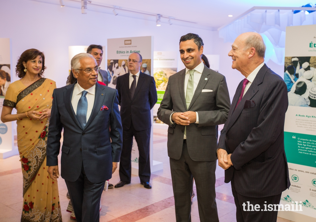 Khurshid Nazim Ahmad, Nazim Ahmad, Prince Amyn and President Rahim Firozali share a light moment at the Ethics in Action exhibition.