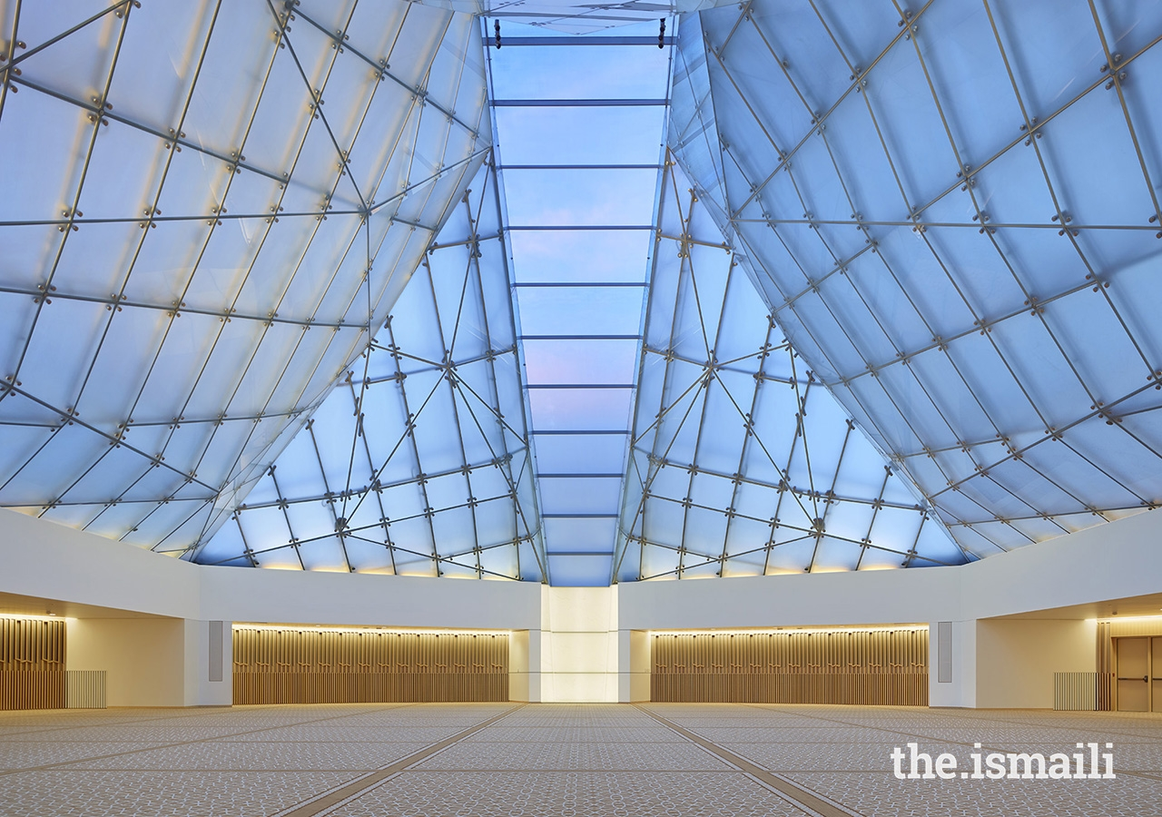 Inside the Jamatkhana at the Ismaili Centre, Toronto, the central skylight panel descends to a white translucent onyx block.