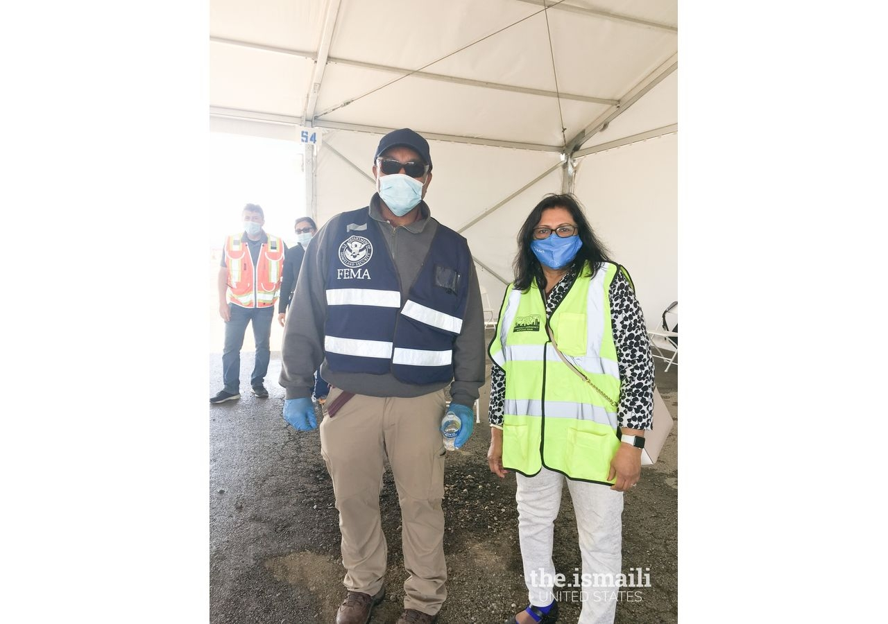 Volunteer Yasmin Pyarali with a FEMA member at the Dallas-Fort Worth Texas Motor Speedway FEMA vaccination site in March 2021.