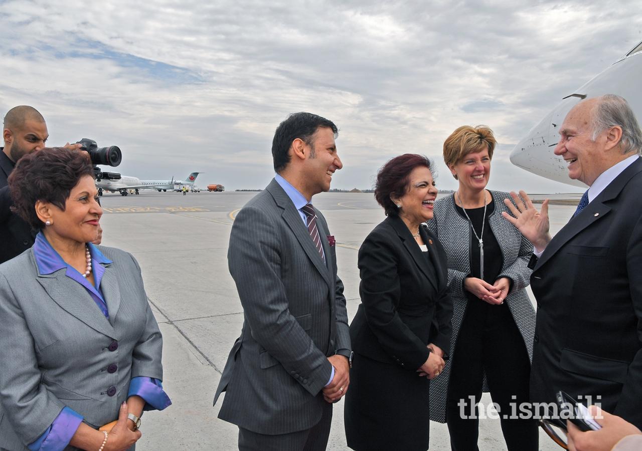Senator Mobina Jaffer and Members of Parliament Arif Virani and Yasmin Ratansi greet Mawlana Hazar Imam at the airport in Ottawa.