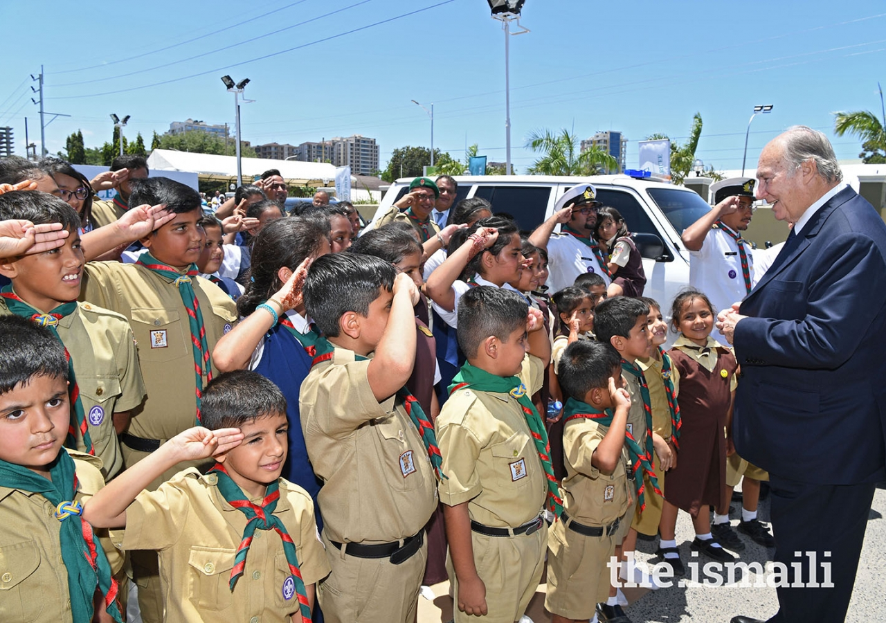 Mawlana Hazar Imam is greeted by Aga Khan Scouts and Guides, as he leaves Diamond Jubilee Hall after the Darbar.