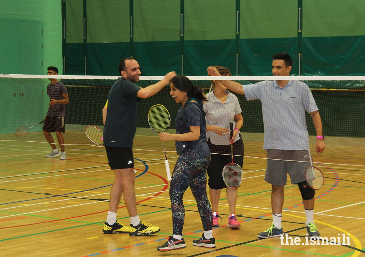Participants congratulate each other at the Badminton competition during the European Sports Festival 2019.