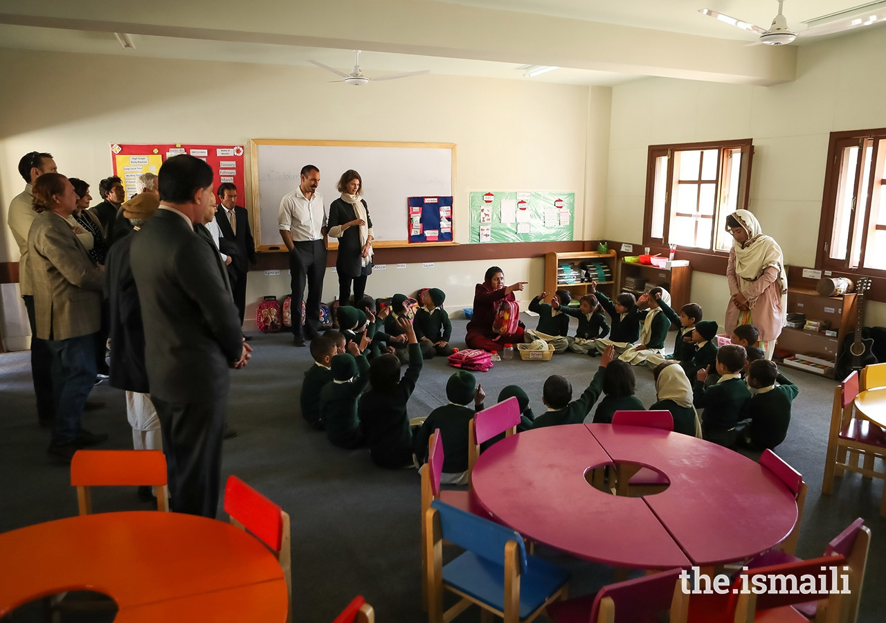 Prince Rahim and Princess Salwa with students and teachers at the Diamond Jubilee School in the village of Darkut, Silgan Valley, Ghizer District, in Gilgit-Baltistan. The school is operated by the Aga Khan Education Services (AKES).