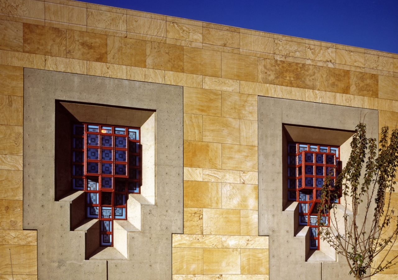 The patterned glass windows take on different colours depending upon the intensity and the direction of light falling upon them.