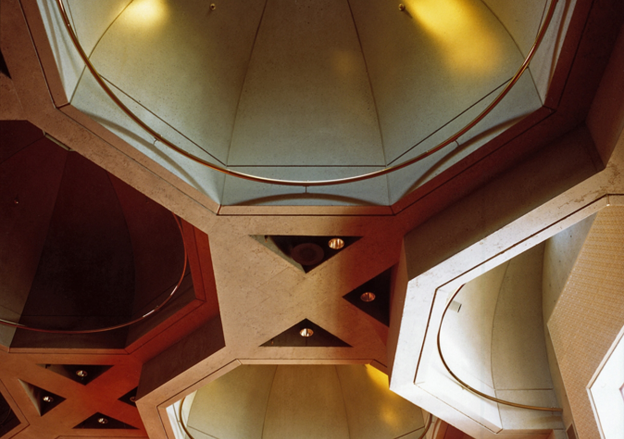 Thirteen octagonal domes with brass circle rings provide natural light.