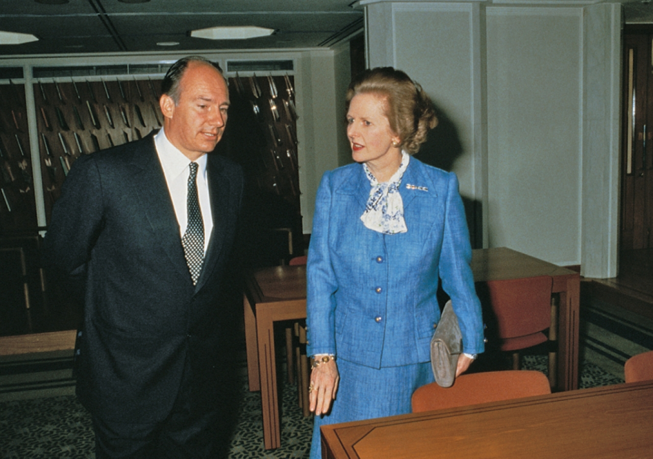 Mawlana Hazar Imam and Prime Minister Margaret Thatcher tour the library of the Ismaili Centre, London.
