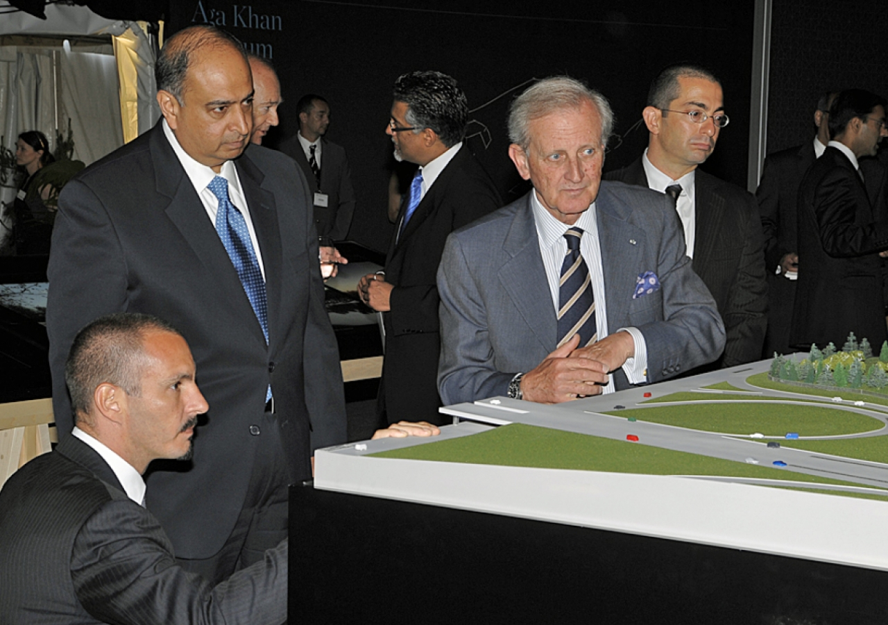 Prince Rahim gets an eye-level look at the architectural model, as Ismaili Council for Ontario President Karim Sunderji, AKTC General Manager Luis Monreal and landscape architect Vladimir Djurovic look on.