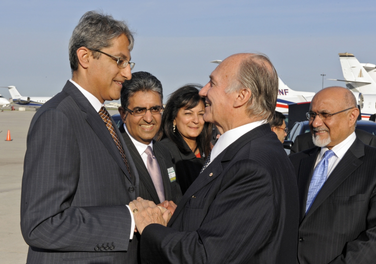 Mawlana Hazar Imam is bid farewell by Ismaili Council for Canada Vice-President Malik Talib and President Mohamed Manji before departing Canada.