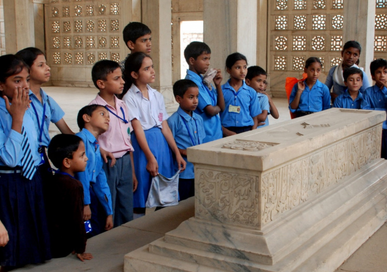 A group of school children in Nizamuddin Basti visit the Chaunsath Khamba, a 17th century tomb. They are guided by AKTC-trained heritage volunteers from the Sair-e-Nizamuddin group.