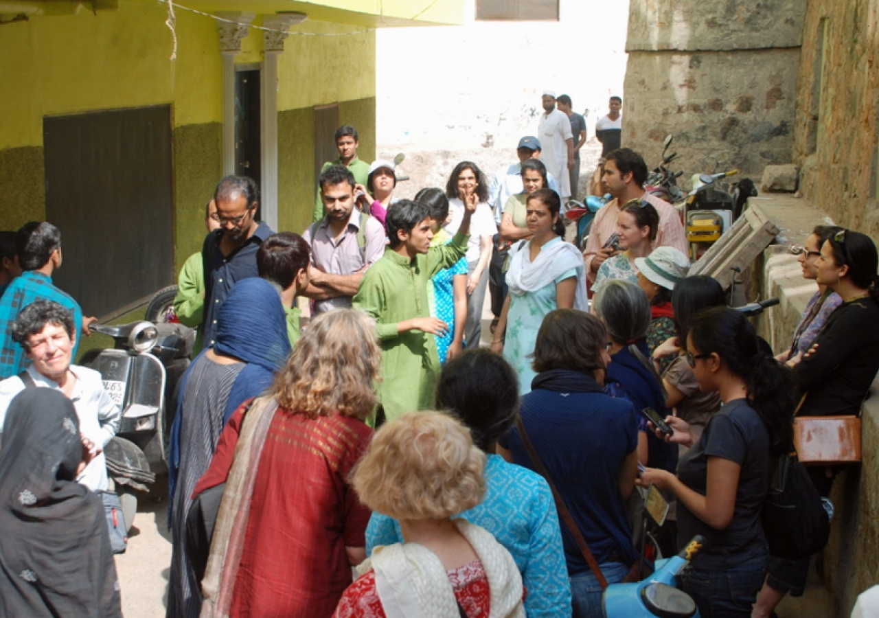 A guide trained by AKTC leads visitors on a tour of the Nizamuddin Basti.
