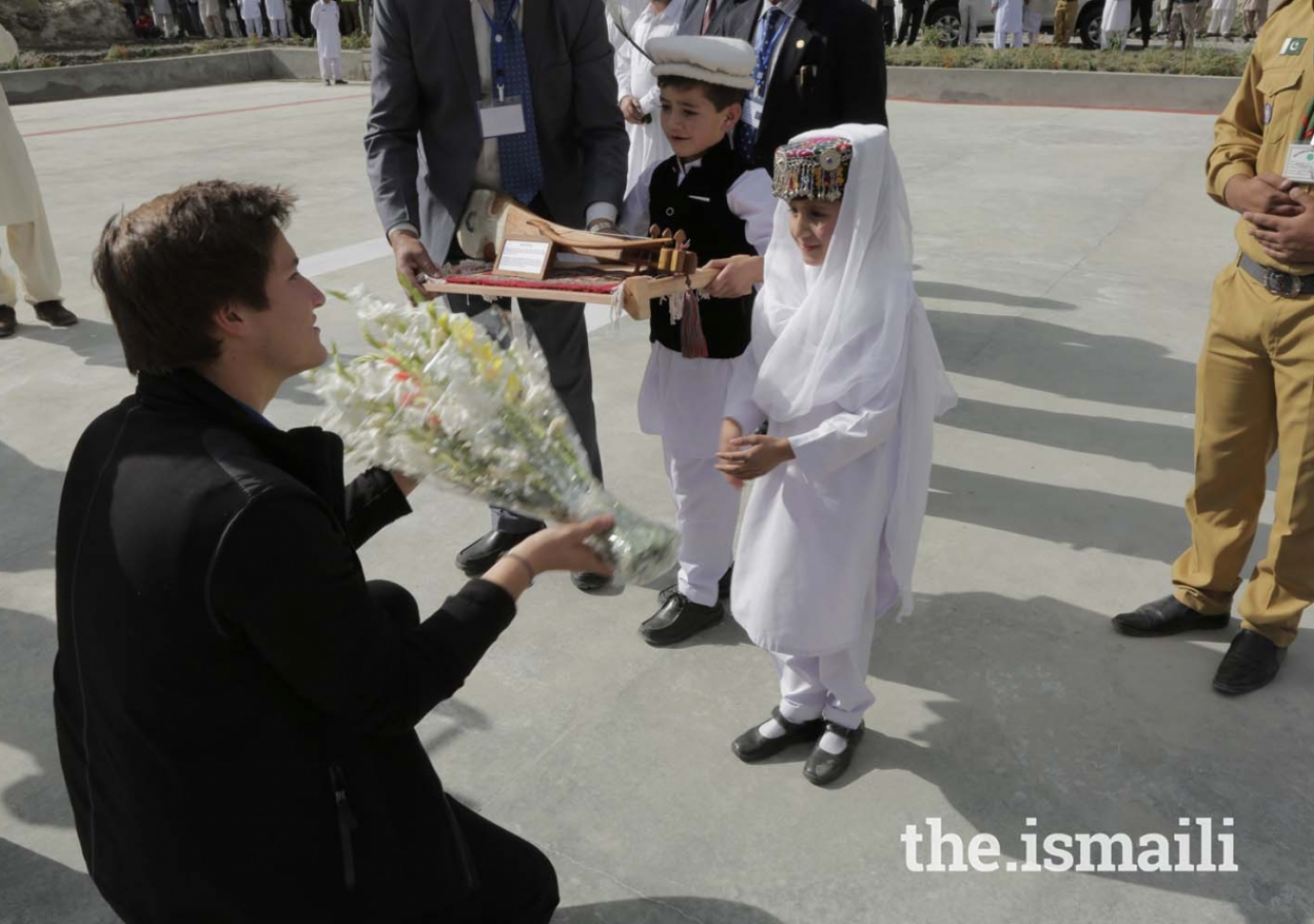 Prince Aly Muhammad is presented a bouquet of flowers upon his arrival in Aliabad, Hunza, Gilgit-Baltistan.