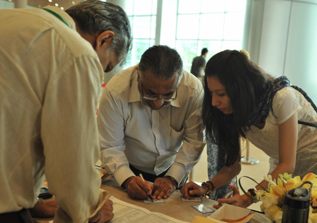Volunteers prepare for registration ahead of Mawlana Hazar Imam's visit with the Far East Jamat.