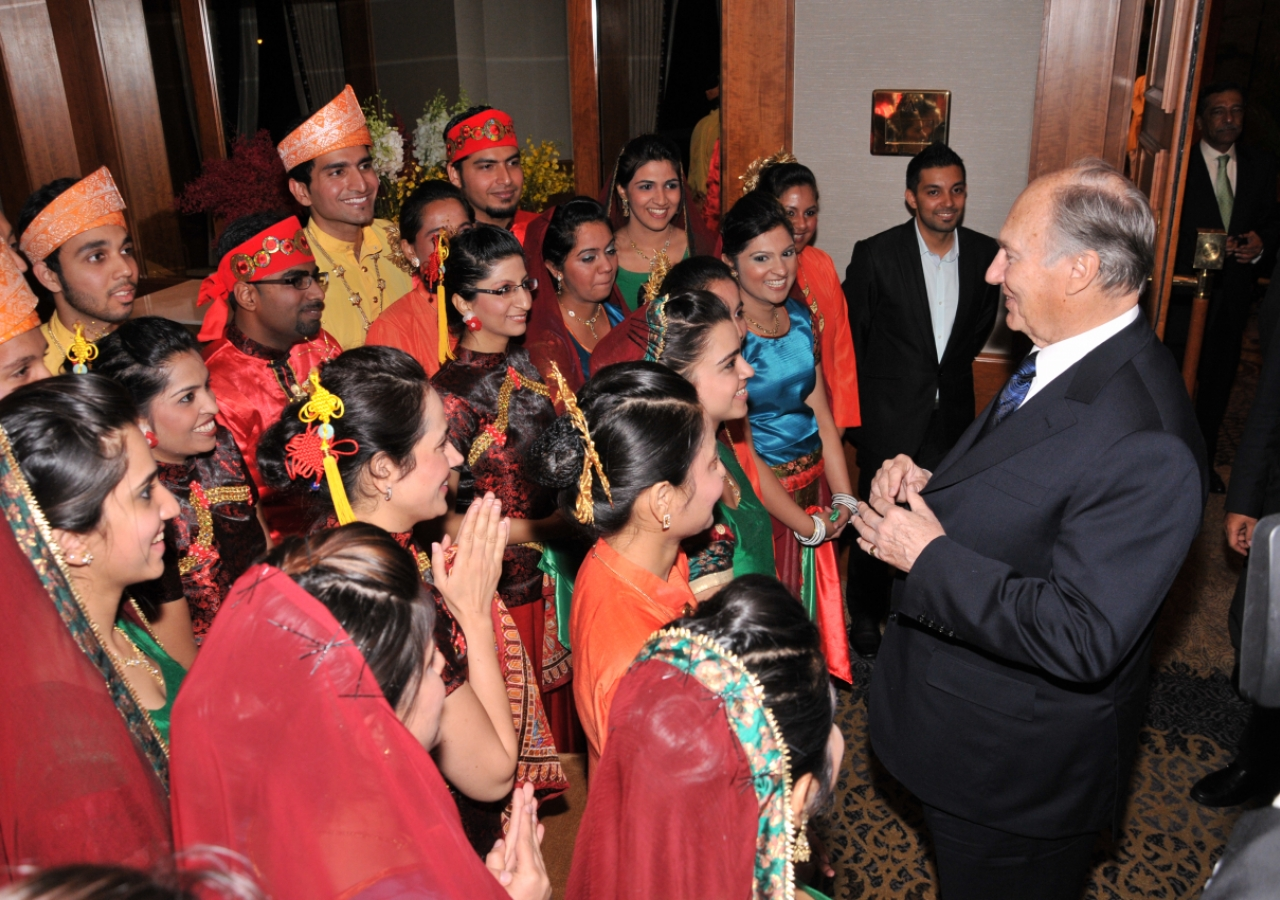 """Mawlana Hazar Imam encourages the young performers to consider a """"dance olympics"""" prior to departing the Far East Institutional Dinner."""