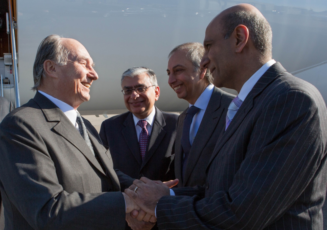 Upon his arrival in Providence, Rhode Island, Mawlana Hazar Imam is received by Ismaili Council for the USA President Barkat Fazal, LIF Chairman Mahmoud Eboo, and Ismaili Council Vice-President Zahir Ladhani.