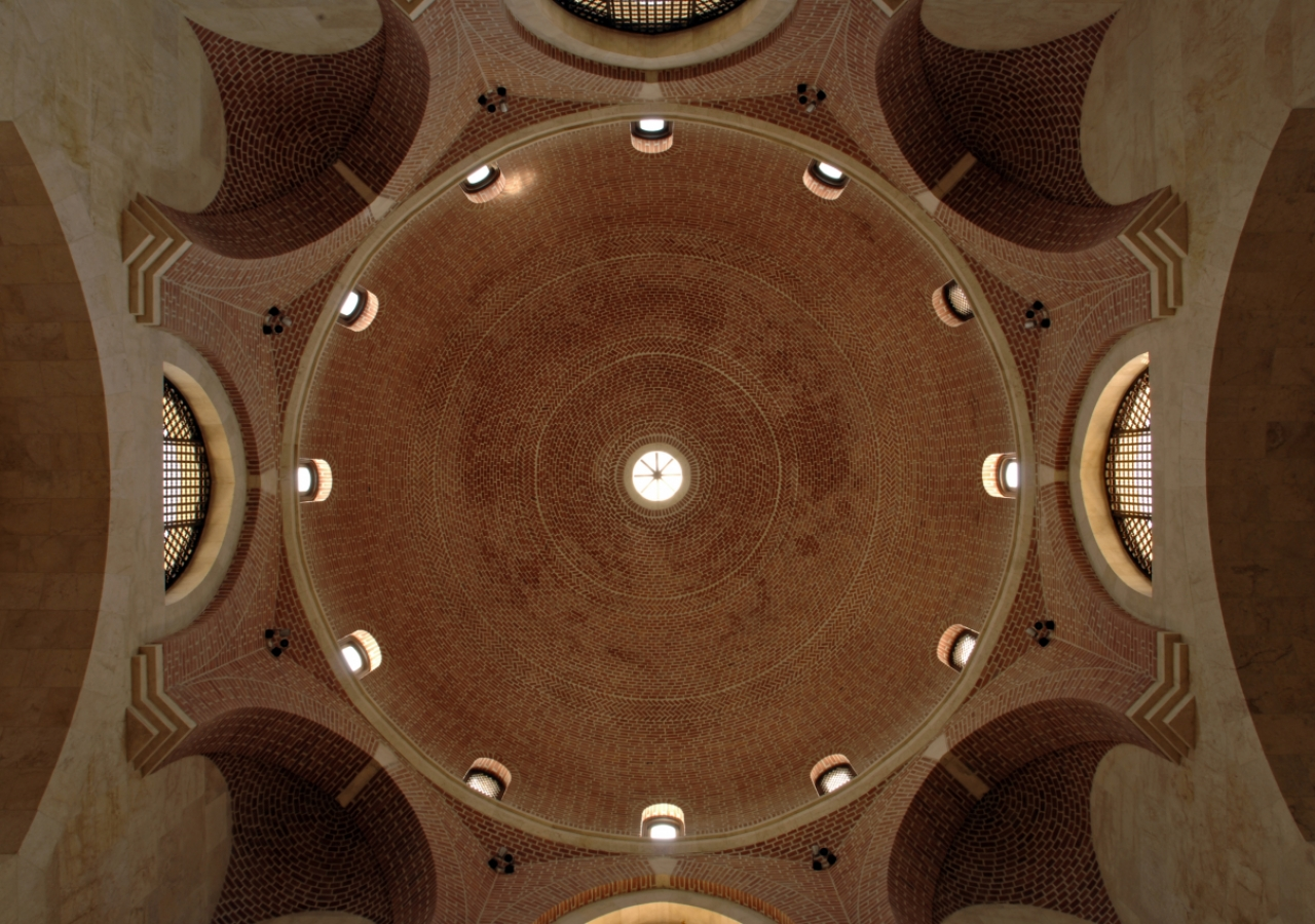 The main entrance hall dome is a visual marvel that rises in a series of arches and corbels upon which the brick dome culminates at its apex.
