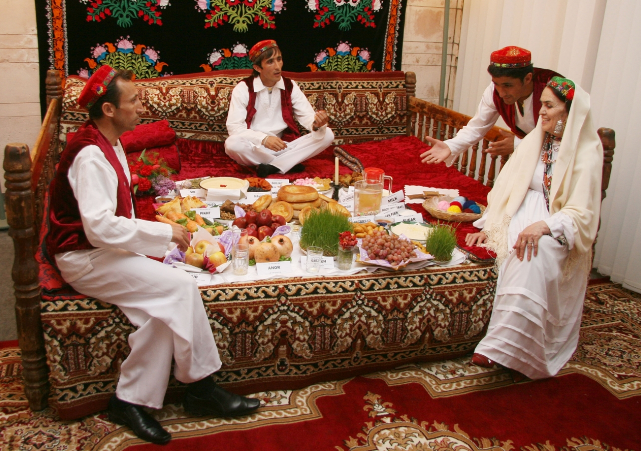 """A family illustrates a traditional Tajik Navroz meal according to the """"haft-shin"""" and """"haft-sin"""" traditions."""