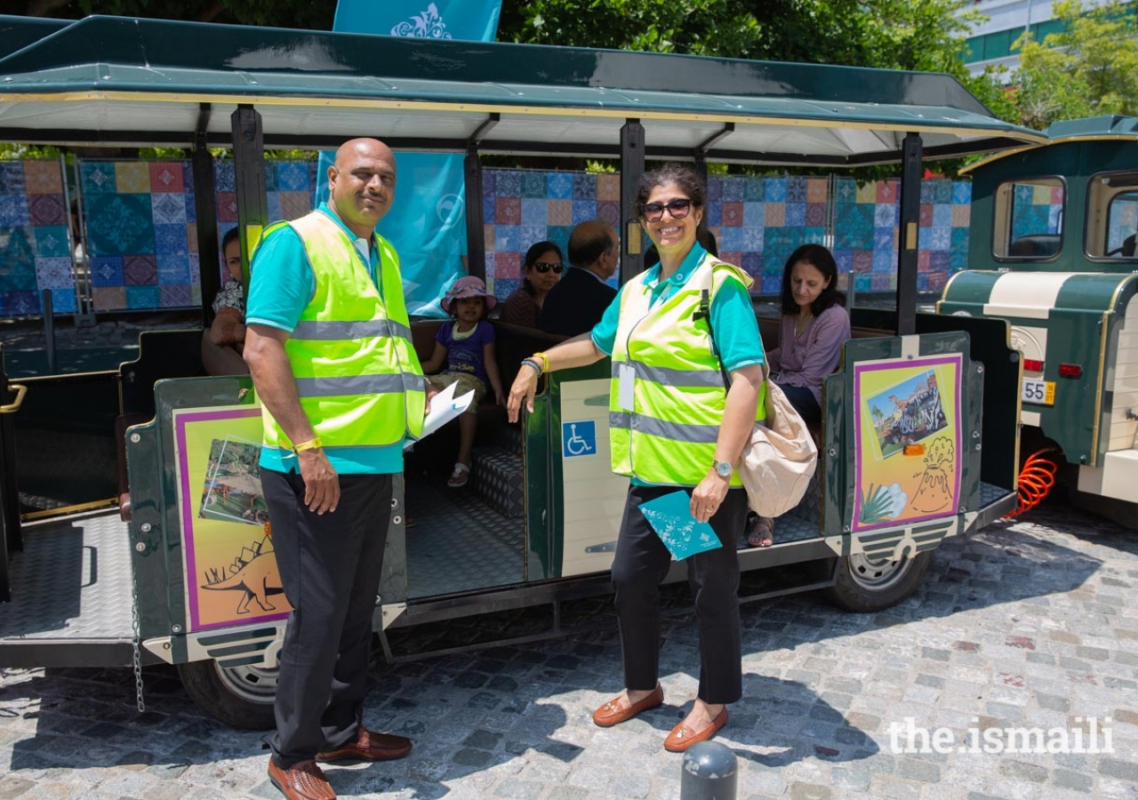 Volunteers are ready for passengers to board the train to travel around the Parque das Nações.
