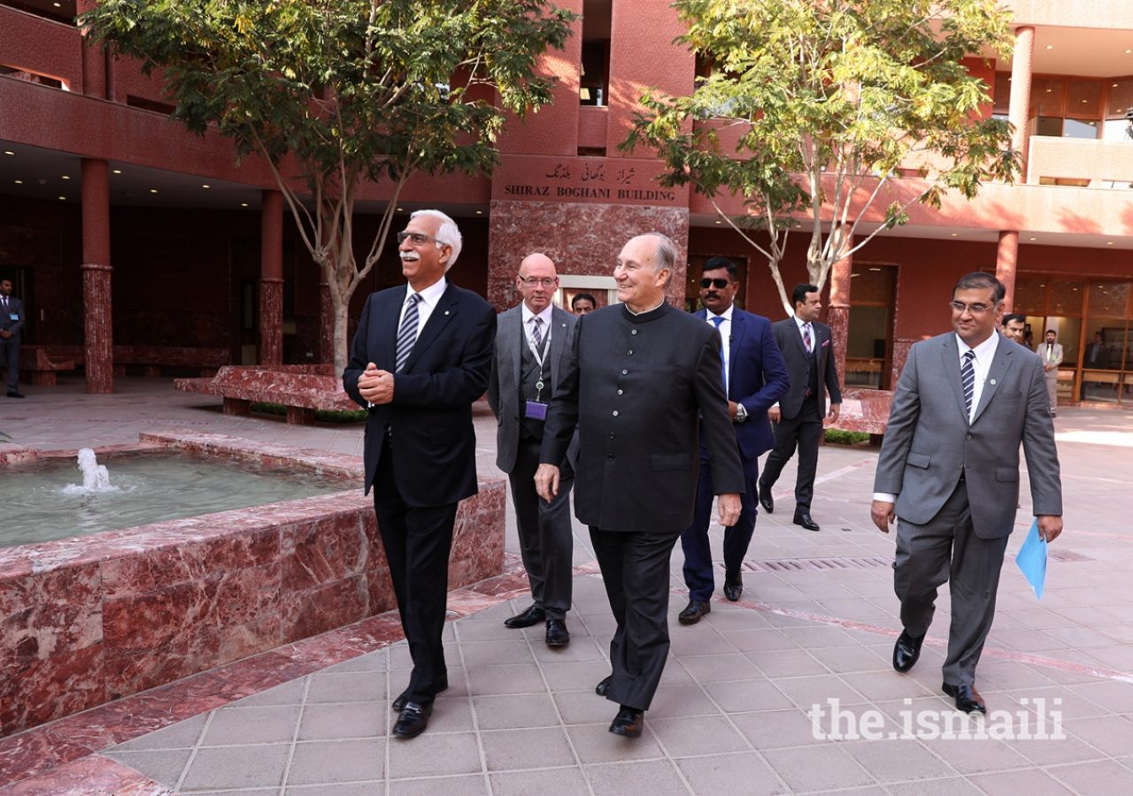 Mawlana Hazar Imam observes the CIME courtyard during a walkabout.